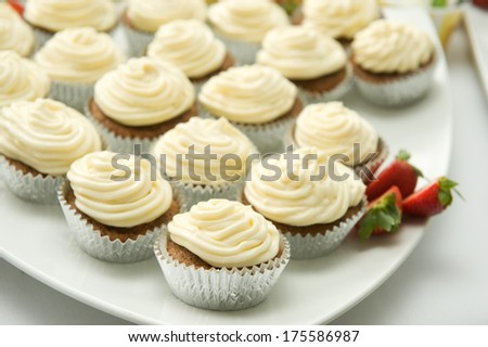 Delicious cupcakes on a platter  - stock photo