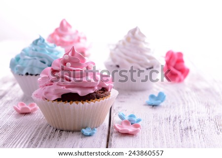 Delicious cupcakes on table close-up - stock photo