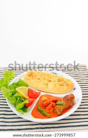 Delicious curry with naan - stock photo