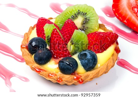 Delicious custard tart with blueberries, kiwi and strawberries - stock photo