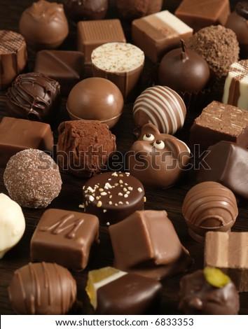 Delicious dark, milk, and white chocolate pralines. - stock photo