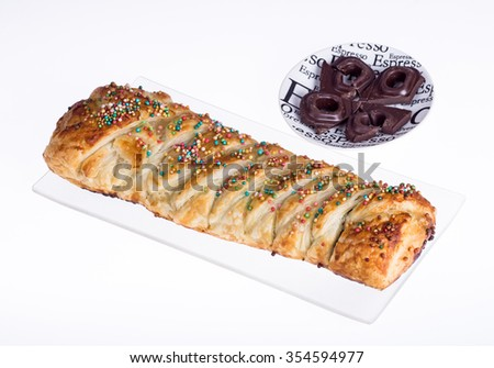 Delicious dessert with puff pastry and chocolate. isolated on white - stock photo