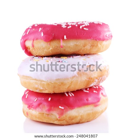 Delicious donuts with icing isolated on white - stock photo