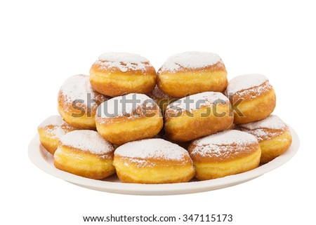 Delicious donuts with powdered sugar on top and chocolate filling on a plate - stock photo
