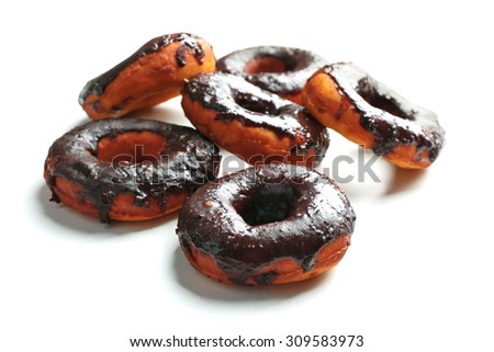Delicious doughnuts with chocolate icing isolated on white - stock photo