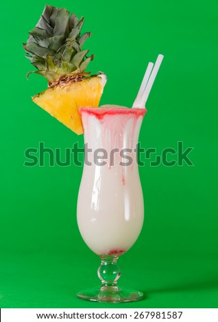Delicious exotic and tropical pina colada drink photographed using complimentary colors, cool refreshing cocktail very popular in tourist resorts in Cuba and the Caribbean - stock photo