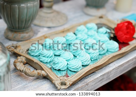 Delicious fancy mint pastila on wooden tray - stock photo