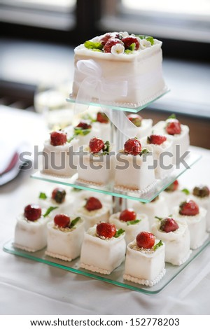 Delicious fancy wedding cake made of strawberry cupcakes - stock photo