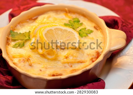 Delicious fish stew dish closeup. At russian dishes - skoblyanka. - stock photo