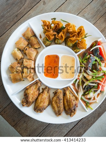 Delicious food.Holiday mixed starters.MINCED CHICKEN&SWEET CORN IN CRISPY CUP, Popular spicy appetizer made of chicken wings,Preserved egg salad, Dim Sum traditional .selective focus - stock photo