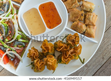 Delicious food.Holiday mixed starters.MINCED CHICKEN&SWEET CORN IN CRISPY CUP, Popular spicy appetizer made of chicken wings,Preserved egg salad, Dim Sum traditional .selective focus. - stock photo