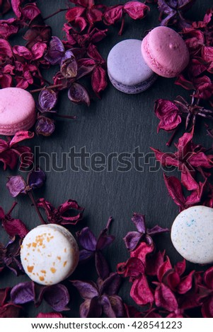 delicious French dessert macarons on a black background - stock photo
