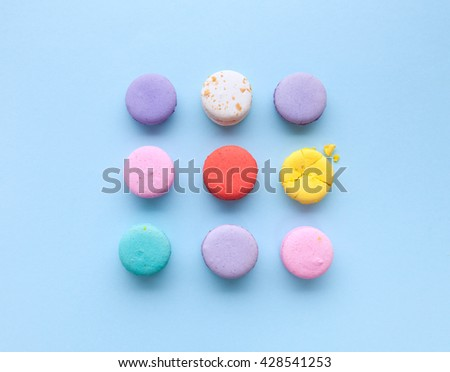 delicious French dessert macarons on a light blue background - stock photo