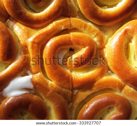 Delicious fresh baked buns pudding background. - stock photo