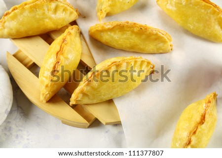 Delicious fresh baked golden cornish pasties ready to serve. - stock photo