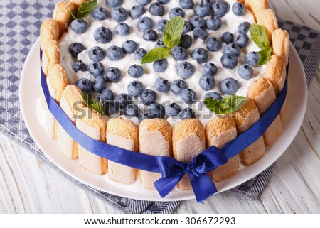 Delicious fresh blueberry cake charlotte close-up on a plate. horizontal - stock photo