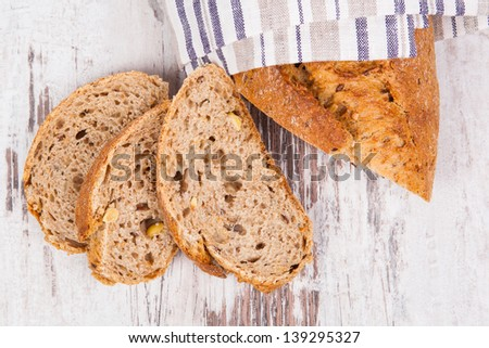 Delicious fresh breakfast. Dark bread on white wooden background, top view. Culinary healthy eating. - stock photo