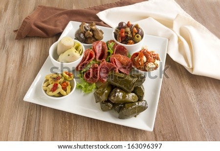Delicious freshly prepared mezze platter cosisting of a variety of mediterranean foods. - stock photo
