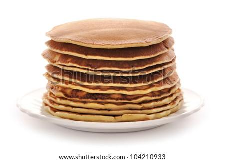 Delicious freshly prepared pancakes isolated on white - stock photo