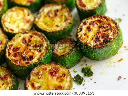 Delicious fried zucchini spices flavored - stock photo
