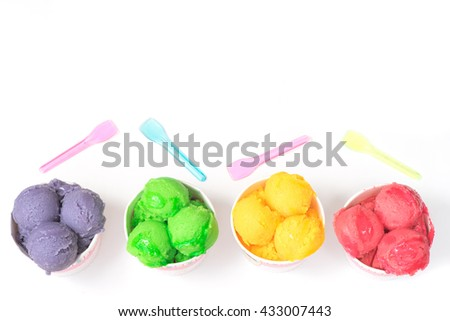 Delicious fruit ice sorbet in paper cups isolated on white. Top view. - stock photo