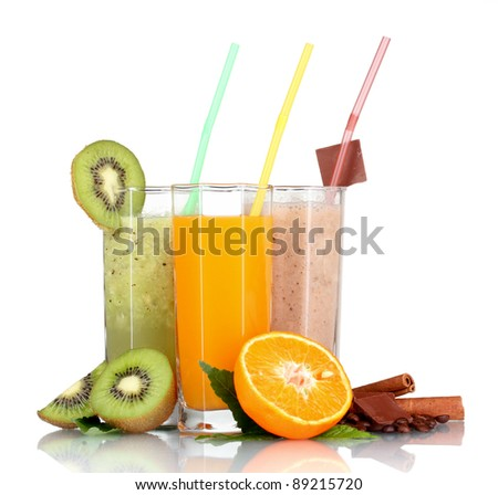 Delicious fruit smoothies and fruits isolated on white - stock photo