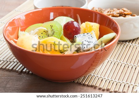 Delicious fruits salad in plate on table close-up, clean food - stock photo