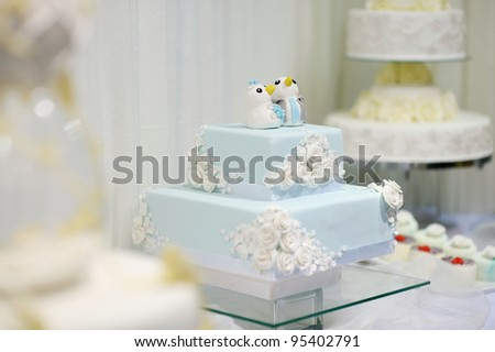 Delicious funny decorated wedding cake - stock photo