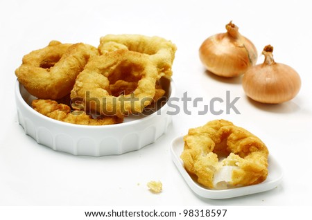 Delicious golden brown, deep fried onion rings - stock photo
