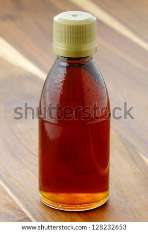 delicious grade A dark amber maple syrup, with a delicious robust bouquet. - stock photo