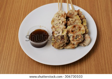 Delicious grilled banana with sweet sauce to eat - stock photo