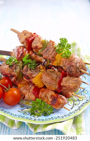 Delicious grilled pork meat and vegetable kebabs - stock photo
