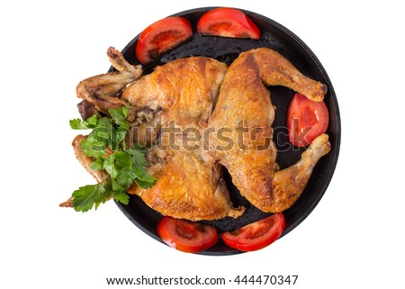 Delicious grilled tabaka chicken with tomatoes on frying pan. Isolated on a white background. - stock photo