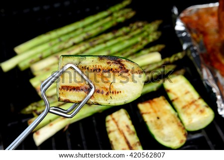 delicious grilled zucchini and asparagus on barbecue - stock photo