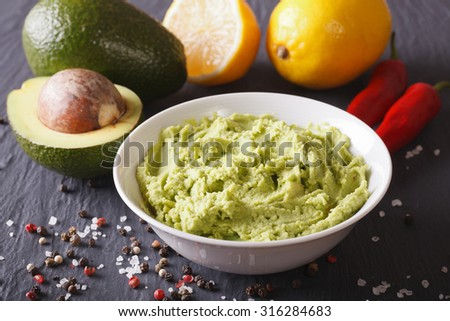 Delicious guacamole sauce and ingredients close-up on the table. horizontal - stock photo