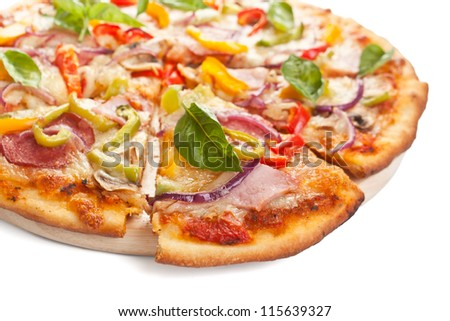 delicious ham, salami,  mushroom and vegetable pizza on a cutting board - stock photo