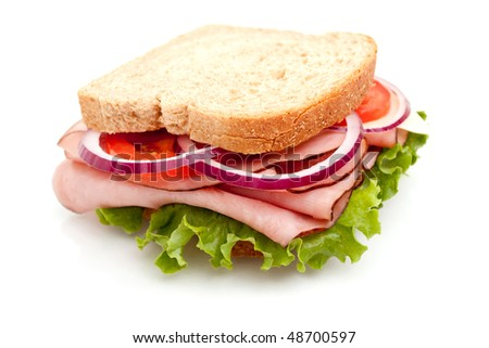 Delicious ham sandwich with whole wheat bread on white background - stock photo
