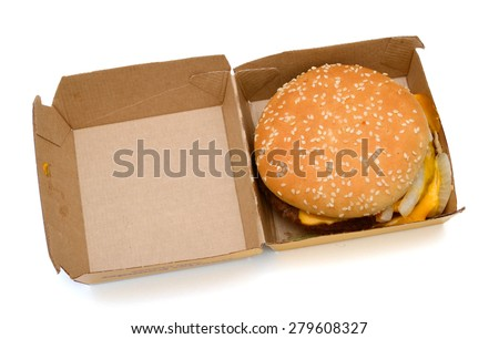delicious hamburger in paper box on white background  - stock photo