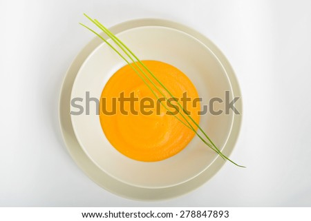 Delicious healthy pumpkin soup in a light dish. View from above. - stock photo