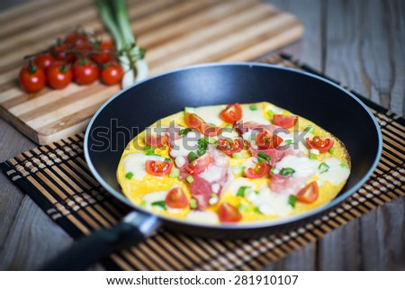 Delicious home made omelet; ham and cheese omelette with fresh v - stock photo