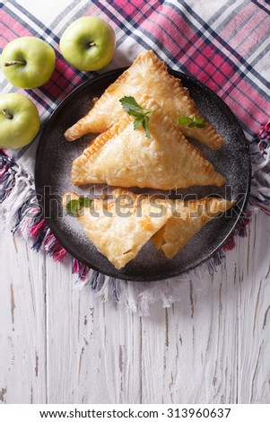 Delicious homemade apple pie turnover on a plate. vertical top view - stock photo