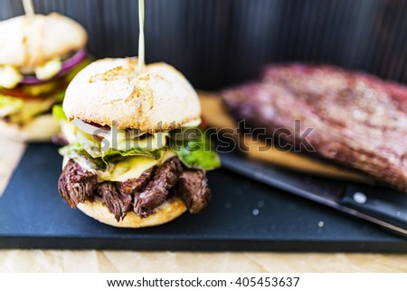 Delicious homemade beef burger with fresh vegetables. - stock photo