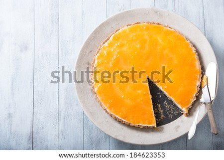 Delicious homemade cheese cake with passion fruit topping - stock photo