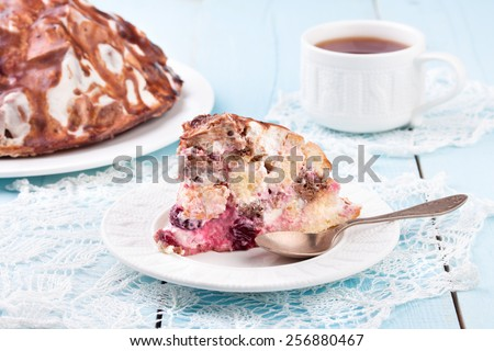 Delicious homemade cherry cake with white cup of tea. Close-up - stock photo