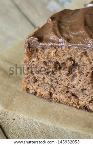 Delicious homemade chocolate brown cake with shallow depth of field  - stock photo