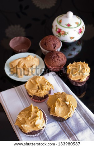 delicious homemade cupcakes with peanut butter icing - stock photo