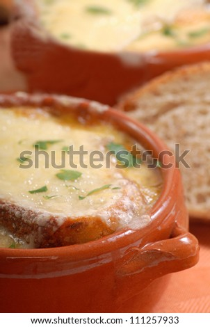 Delicious homemade French Onion Soup with crusty rye bread - stock photo