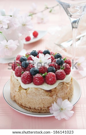 Delicious homemade fruit cake with fresh berries garnish.Selective focus. - stock photo