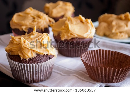 delicious homemade muffins with peanut butter icing - stock photo