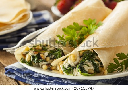 Delicious Homemade Savory French Crepes with Spinach and Feta - stock photo